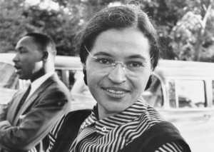 A 1955 snapshot of Rosa Parks sitting on a park bench near civil rights leader Martin Luther King, Jr. (Wikimedia Commons)