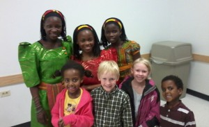 After the performance, our kids posed with three of the Watoto children in the traditional Ugandan dress. (Marrton Dormish)