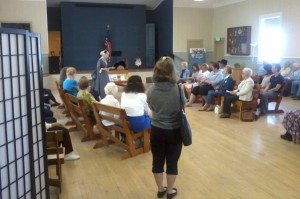 Attendees look on during a living history presentation at the Crescent Grange in Broomfield, Colo. (Marrton Dormish)