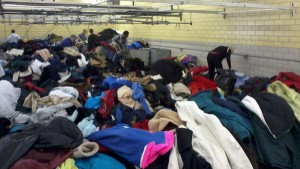 Volunteers sift through coats in one corner of Dependable Cleaners' Coats For Colorado warehouse in Denver, Colo. (Marrton Dormish)