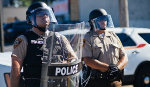 Police in riot gear at Ferguson, Mo., protests in August 2014. (Jamelle Bouie via Wikimedia Commons)