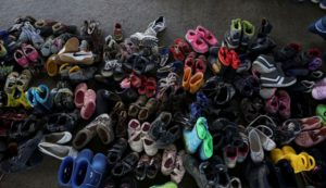 Shoes left behind in Hungary by child refugees. (Mstyslav Chernov via Wikimedia Commons)