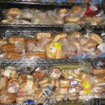 A rack of packaged bread waits for distribution at the North Denver Cares (NDC) food pantry in Broomfield, Colo. While the Summer Food Service Program only operates when school is out, NDC is open year-round. (Marrton Dormish)