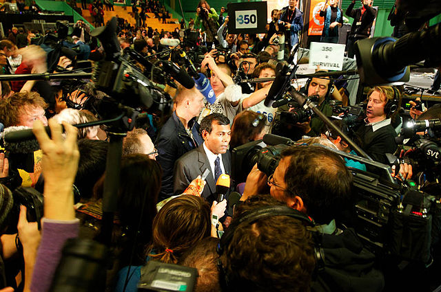 Mohamed Nasheed of the Maldives briefs reporters during the 2009 Copenhagen climate change talks. At the time, Nasheed was president of the Maldives, but he was forced to resign under threat of violence from a coup in February 2012. (Adam Wells, tcktcktck campaign, via Wikimedia Commons)
