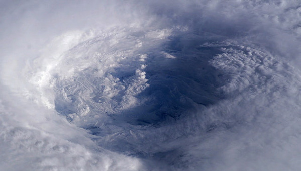 NASA astronaut Ed Lu took this image of the eye of Hurricane Isabel from the International Space Station on Sept. 13, 2003. At the time of the image, Isabel was a Category 4 hurricane. The storm was located about 450 miles northeast of Puerto Rico. (Ed Lu via Wikimedia Commons, Public Domain)