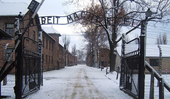 "The entrance to the concentration camp Auschwitz I reads ""Arbeit macht frei"" -- ""Work makes (one) free."" (Logaritmo via Wikimedia Commons)"