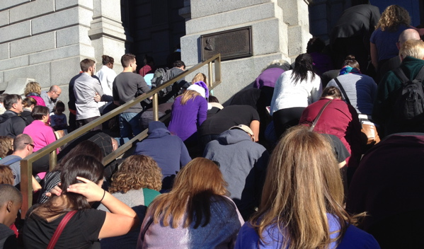 Members of Denver-area faith communities kneel on the steps of the Colorado State Capitol during a recent prayer vigil for justice, peace and an end to racism. (Marrton Dormish)