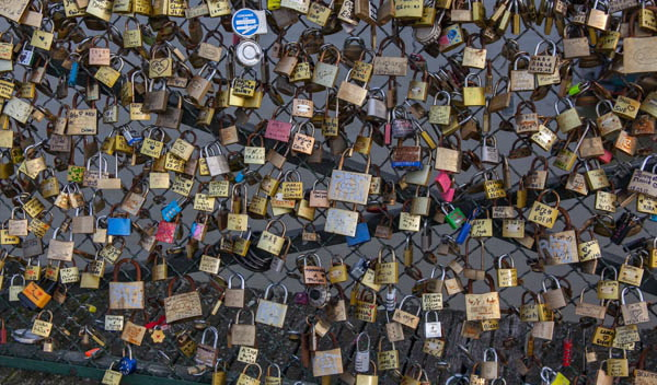 Locks placed couples as symbols of their love on the Pont des Arts bridge in Paris, France. (Frank Kovalchek via Wikimedia Commons)