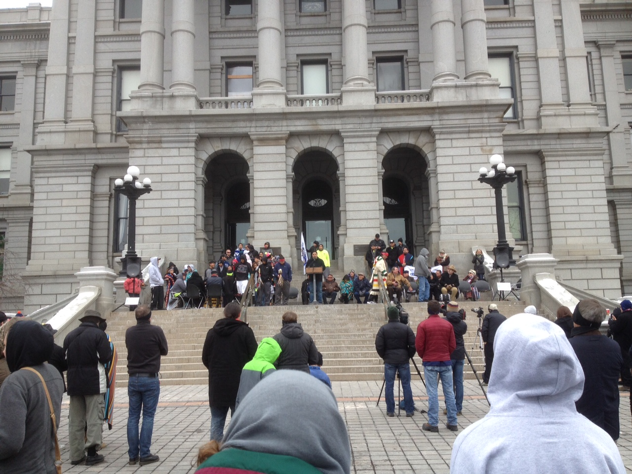 Cheyenne and Arapaho tribal leaders and memorial runners joined state representatives on the steps of the state capitol on Nov. 29 to remember the Sand Creek Massacre. (Marrton Dormish)